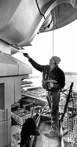 The Feb. 9, 1977 photo caption read: Nearly 40 floors up, Joe Eggerling dabs mortar into a joint in a terra cotta cornice supporting the roof of the 42-story Smith Tower as renovation of the 63-yeard-old Pioneer Square landmark progresses. Photo: P-I File / P-I File