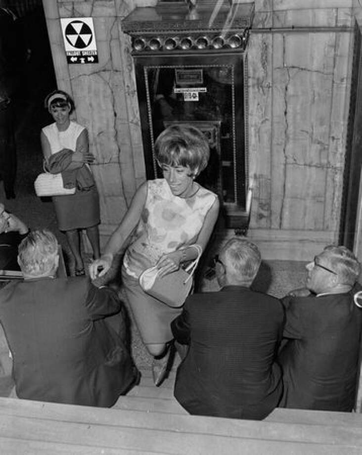 A June 1966 walkout stalled elevators, so Karen Tinker climbed to the 24th floor. Photo: P-I File / P-I File
