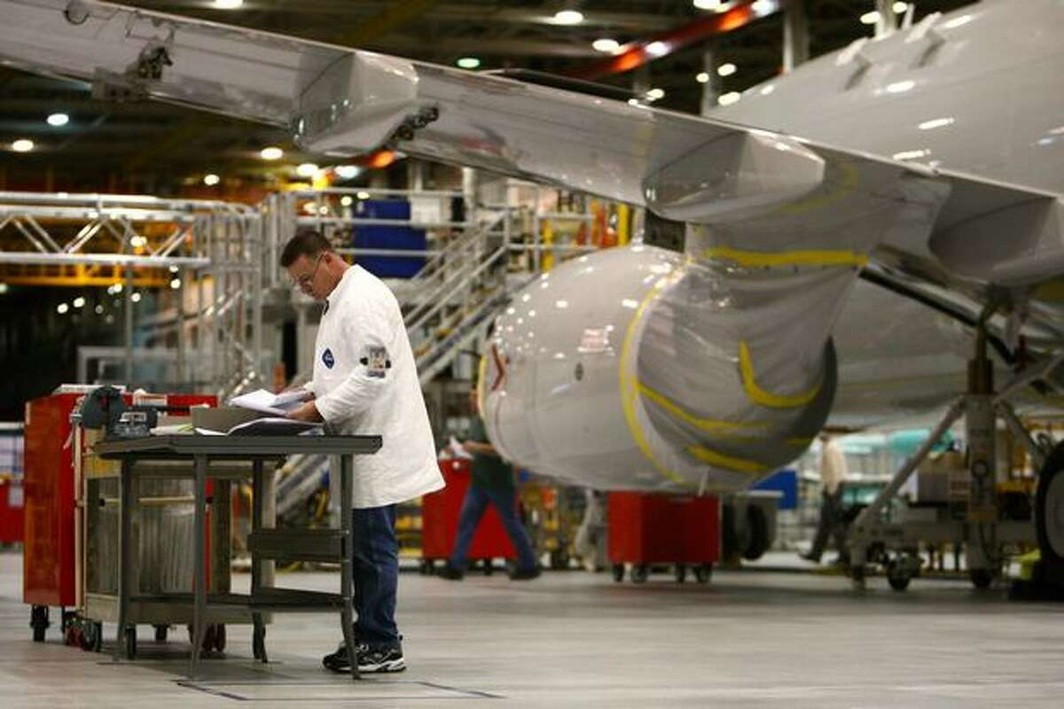 Workers assemble the fourth flight-test U.S. Navy P-8 Poesidon at Boeing's P-8 plant, near Boeing Field, in Seattle. Boeing sends 737s to the plant for P-8 systems installation and testing.