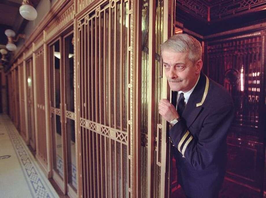 Kumar Natarajam, Smith Tower elevator operator, shown December 28, 1999. Photo: P-I File / P-I File