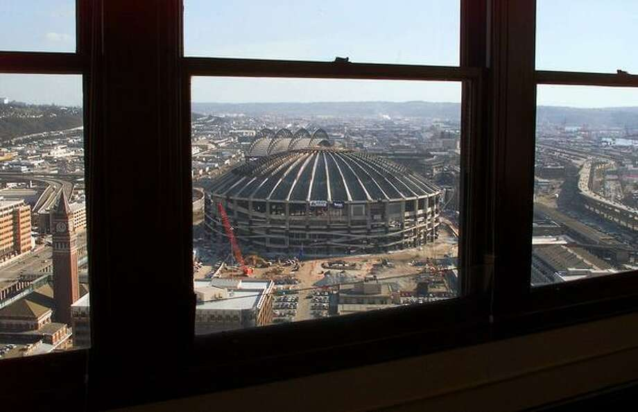A 2001 photo of the soon-to-be-demolished Kingdome from the 32nd floor of the Smith Tower. Photo: P-I File / P-I File