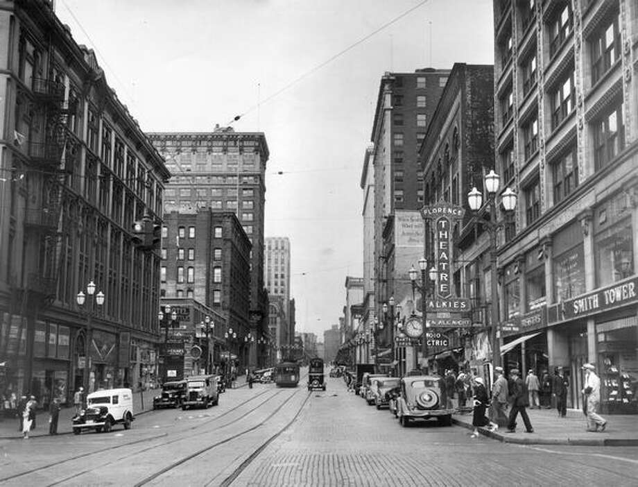 Second Avenue and Yesler Way looking north on Second Avenue in 1935. The Smith Tower, on the right, took the site of a former Bartell Drugs. Photo: P-I File / P-I File