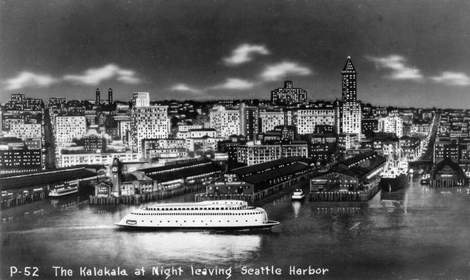 The ferry Kalakala cruises past the Seattle waterfront in this undated  photo postcard. (Seattlepi.com file/Museum of History and Industry) Photo: P-I File / P-I File
