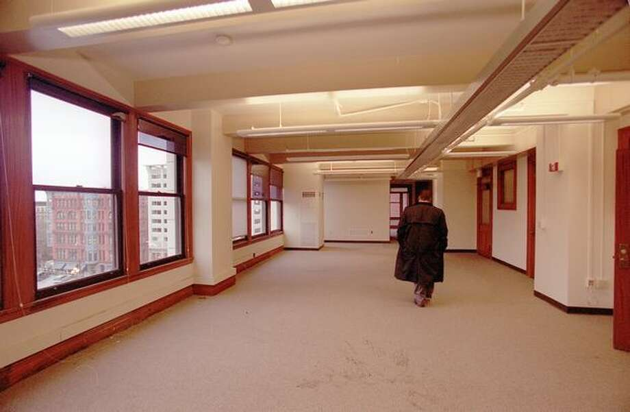A security guard walks though 6th floor Smith Tower office space in this undated photo. Photo: P-I File / P-I File