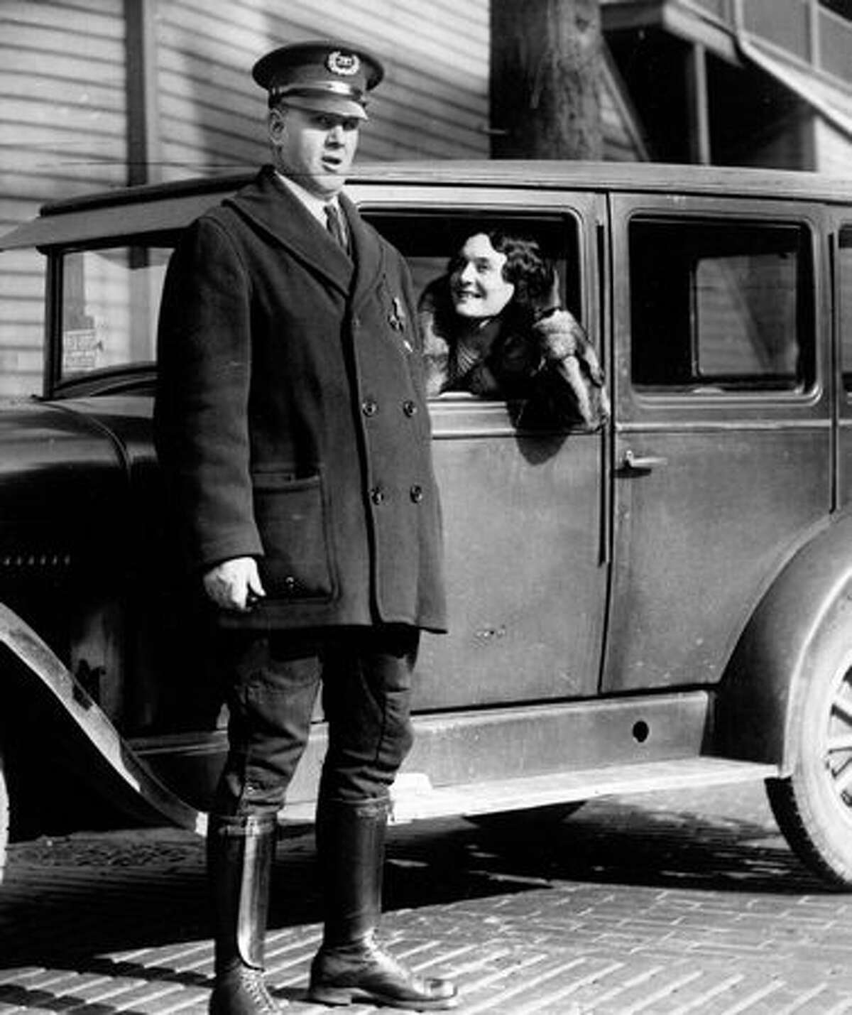 An unidentified Seattle police officer and a woman, Feb. 6, 1931. Seattle police during a June 6, 1934 ceremony. The original photo does not include additional information.