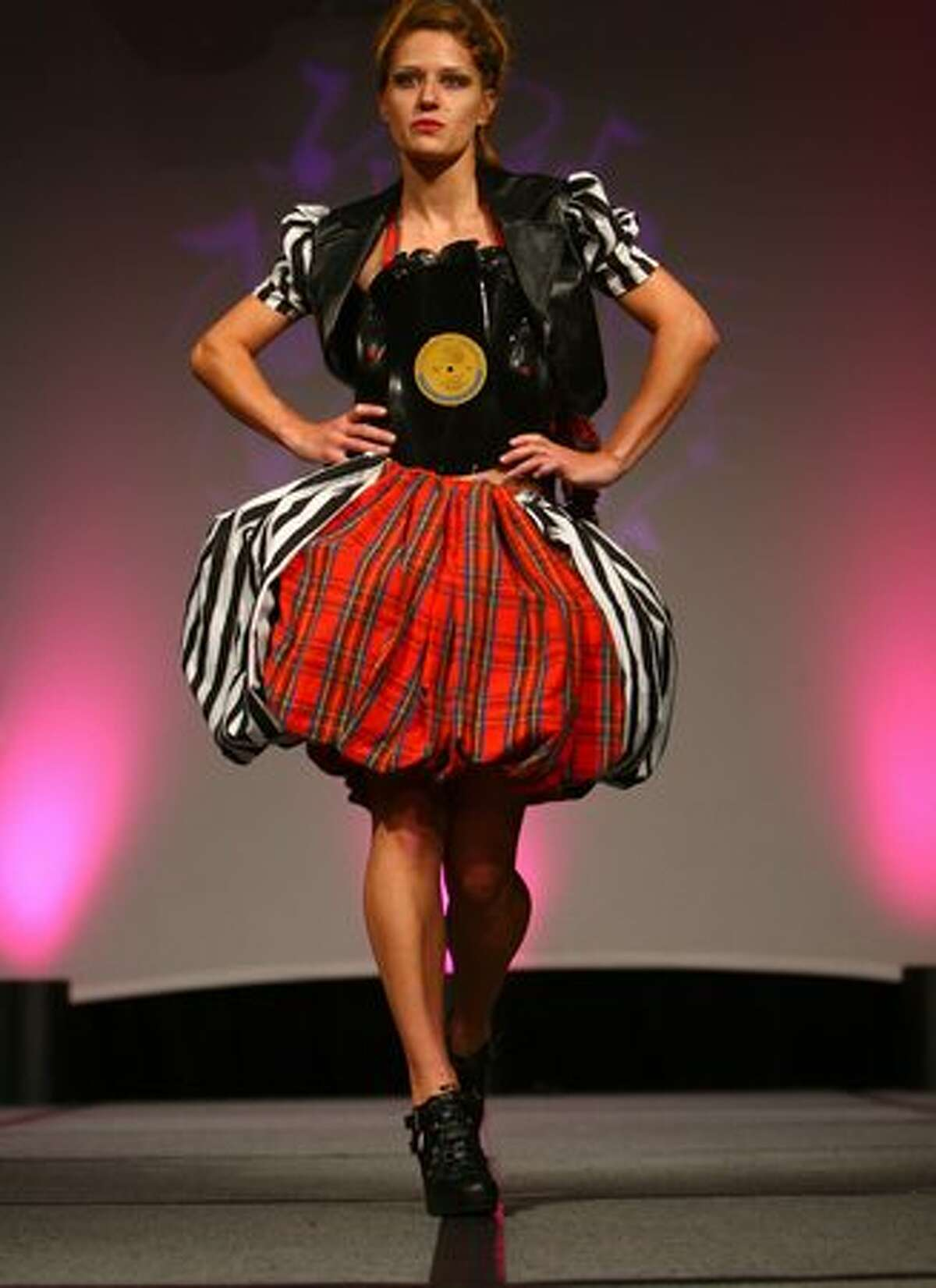 A model walks the runway during Seattle Goodwill's Glitter Gala fashion show on Thursday at the Sheraton hotel. Models wore outfits that were donated to local Goodwill stores.