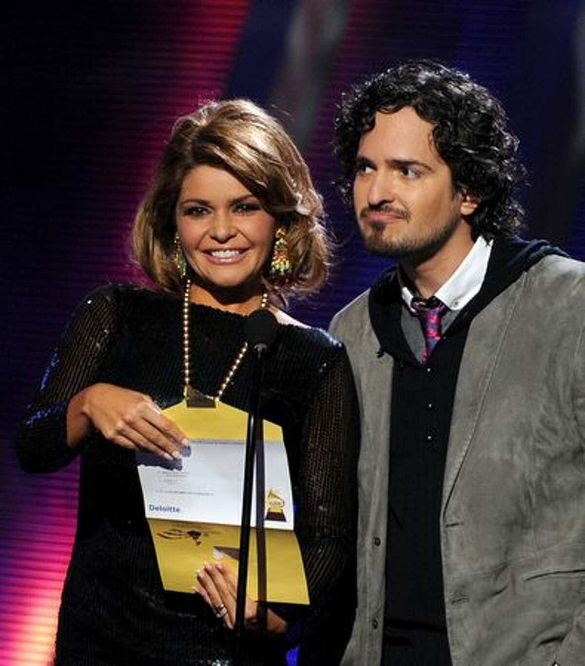 Actress Itati Cantoral (L) and singer Tommy Torres present an award onstage during the 11th annual Latin GRAMMY Awards at the Mandalay Bay Events Center in Las Vegas, Nevada.