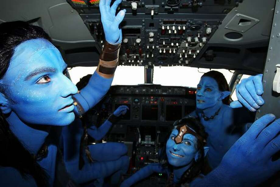 "Models dressed up as characters from the film ""Avatar"" pose in the flight deck of an Avatar-themed Virgin Blue Boeing 737 during the launch of ""Avatar"" Blu-ray and DVD at Sydney Domestic Airport, in Sydney, Australia. Photo: Getty Images"