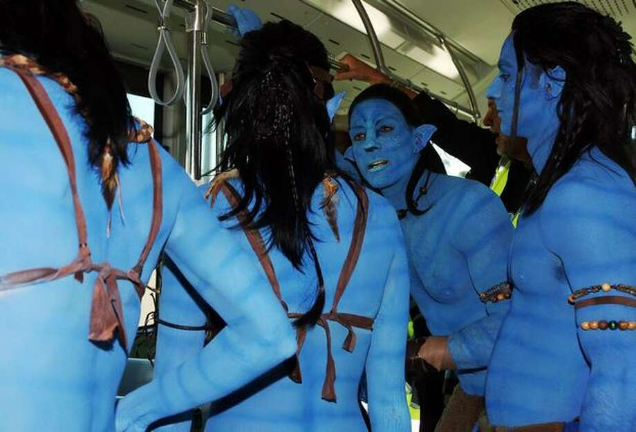 "Models dressed up as characters from the film ""Avatar"" chat on an airport shuttle bus during the launch of ""Avatar"" Blu-ray and DVD at Sydney Domestic Airport, in Sydney, Australia. Photo: Getty Images"