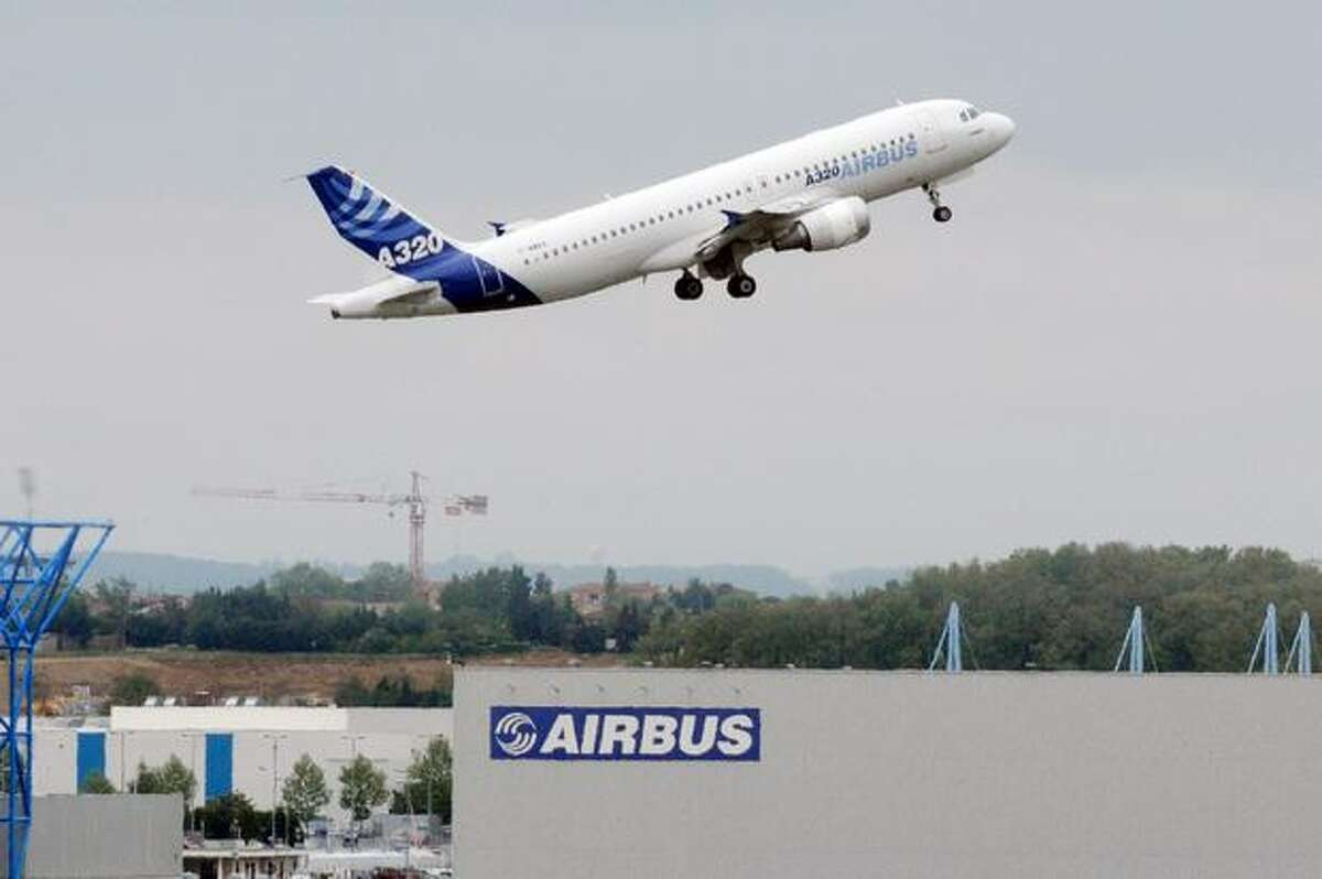 An Airbus A320 takes off from Airbus headquarters in Toulouse, France. Unions at Airbus's French sites called on workers to end their strikes today after management offered to reopen pay talks. Since April 26, unions at three Airbus plants organized rotating strikes on assembly lines to press demands for higher pay and oppose moves to shift some production to Germany.