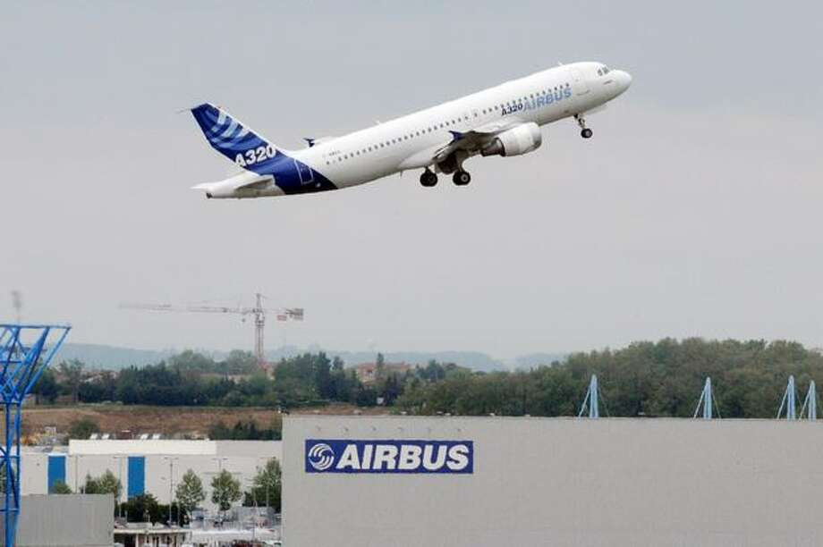 An Airbus A320 takes off from Airbus headquarters in Toulouse, France. Unions at Airbus's French sites called on workers to end their strikes today after management offered to reopen pay talks. Since April 26, unions at three Airbus plants organized rotating strikes on assembly lines to press demands for higher pay and oppose moves to shift some production to Germany. Photo: Getty Images