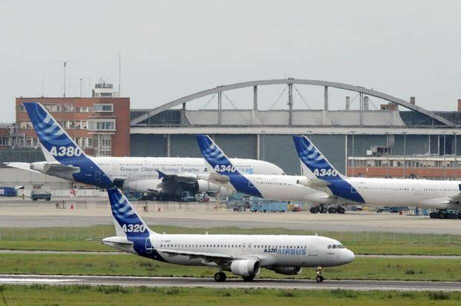 Airbus aircraft are pictured at Airbus headquarters in Toulouse, France. Unions at Airbus's French sites called on workers to end their strikes today after management offered to reopen pay talks. Since April 26, unions at three Airbus plants organized rotating strikes on assembly lines to press demands for higher pay and oppose moves to shift some production to Germany. Photo: Getty Images