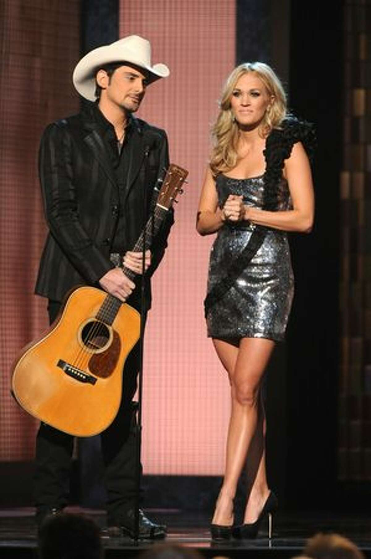 Hosts Brad Paisley and Carrie Underwood perform onstage at the 44th Annual CMA Awards at the Bridgestone Arena on Wednesday in Nashville, Tennessee.
