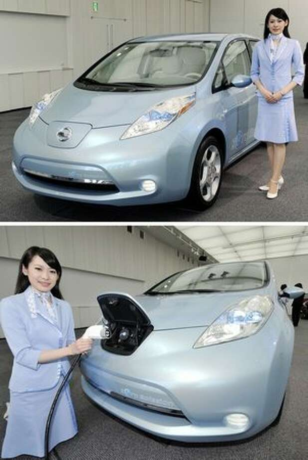 "A combo picture shows an employee of Japan's auto giant Nissan posing with their new electric vehicle, the ""Leaf"", a five-door, hatchback which can run more than 160km on a full charge of battery at the company's design centre at Atsugi city in Kanagawa prefecture, suburban Tokyo on September 25, 2009 ,for a preview of the Tokyo Motor Show. The Leaf is expected to go on sale in next year. The Tokyo Motor Show will start on October 23. AFP PHOTO / Yoshikazu TSUNO Photo: Getty Images"