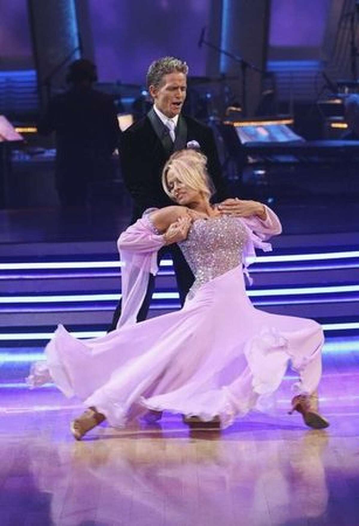 Pamela Anderson and Damian Whitewood, performing a waltz.