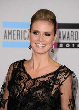 Model Heidi Klum arrives at the 2010 American Music Awards held at Nokia Theatre L.A. Live  in Los Angeles. Photo: Getty Images
