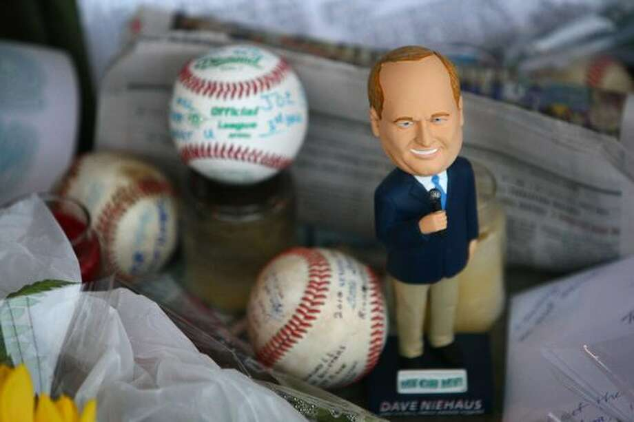 A bobblehead doll is shown during a tribute for Dave Niehaus on Saturday at Safeco Field in Seattle. Niehuas died earlier in the week from a heart attack. The popular play-by-play announcer was the voice of the Seattle Mariners since the team's inaugural season in 1977. Photo: Joshua Trujillo, Seattlepi.com