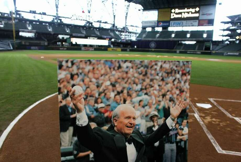 An image of Dave Niehaus is shown at home plate during a tribute for Niehaus on Saturday at Safeco Field in Seattle. Niehuas died earlier in the week from a heart attack. The popular play-by-play announcer was the voice of the Seattle Mariners since the team's inaugural season in 1977. Photo: Joshua Trujillo, Seattlepi.com