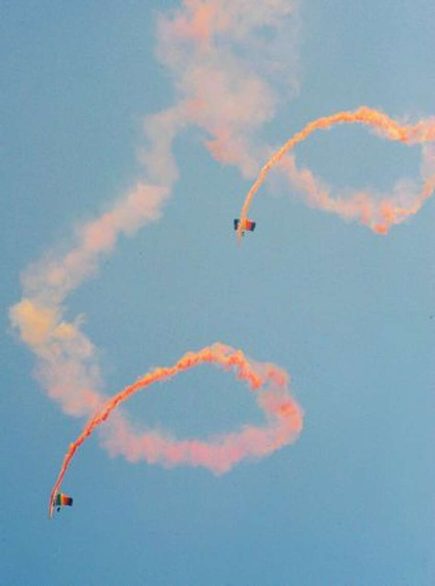 Parachutists perform aerobatics during China International Aviation and Aerospace Exhibition (also known as Airshow China and Zhuhai Airshow) in Zhuhai, China.