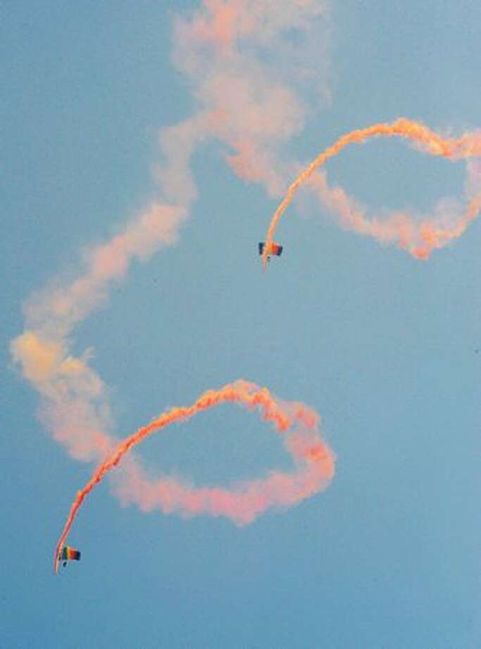 Parachutists perform aerobatics during China International Aviation and Aerospace Exhibition (also known as Airshow China and Zhuhai Airshow) in Zhuhai, China. Photo: Getty Images
