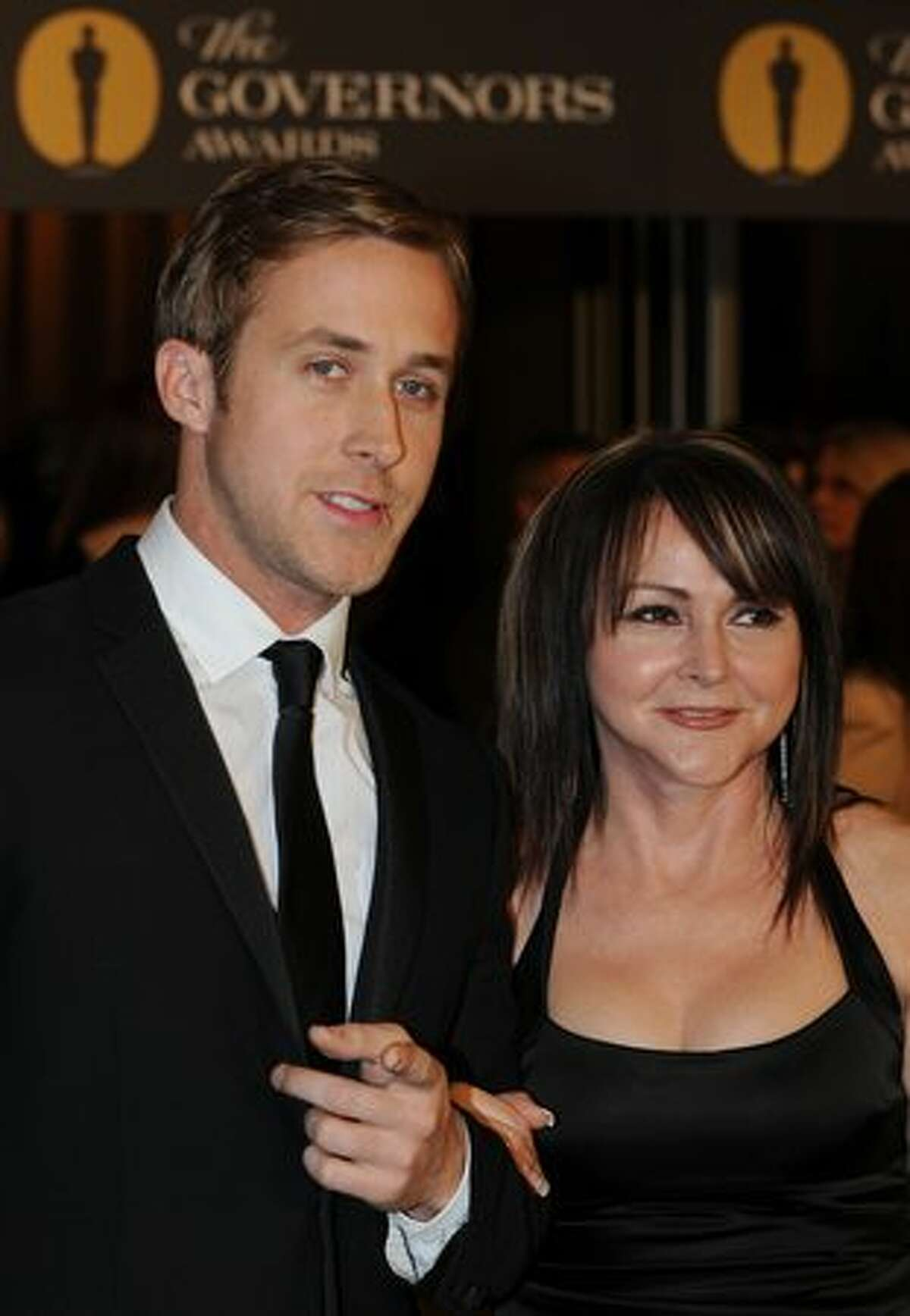 Actor Ryan Gosling and partner arrive on the red carpet for the 2010 Oscars Governors Ball at the Hollywood and Highland Center in Hollywood.