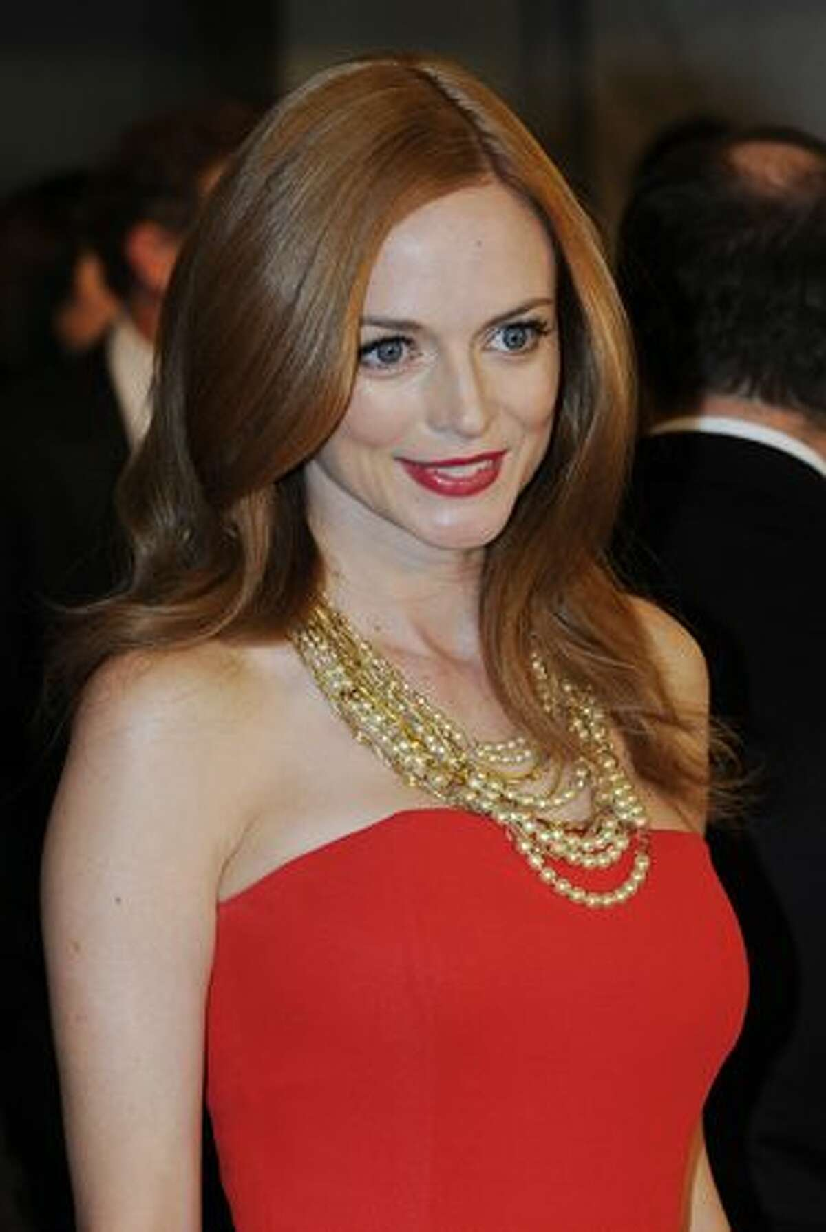 Actress Heather Graham arrives on the red carpet for the 2010 Oscars Governors Ball.
