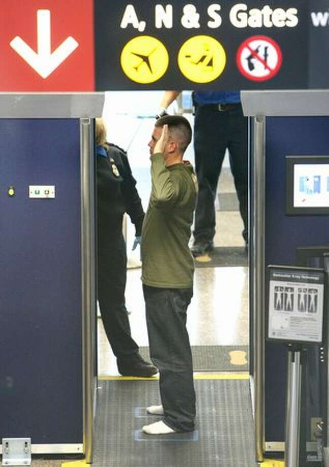 An unidentified passenger passes through one of TSA's full-body backscatter X-ray scanner at SeaTac International Airport on Wednesday, November 24, 2010. Travelers breezed through lines at Sea-Tac. Photo: Joshua Trujillo, Seattlepi.com