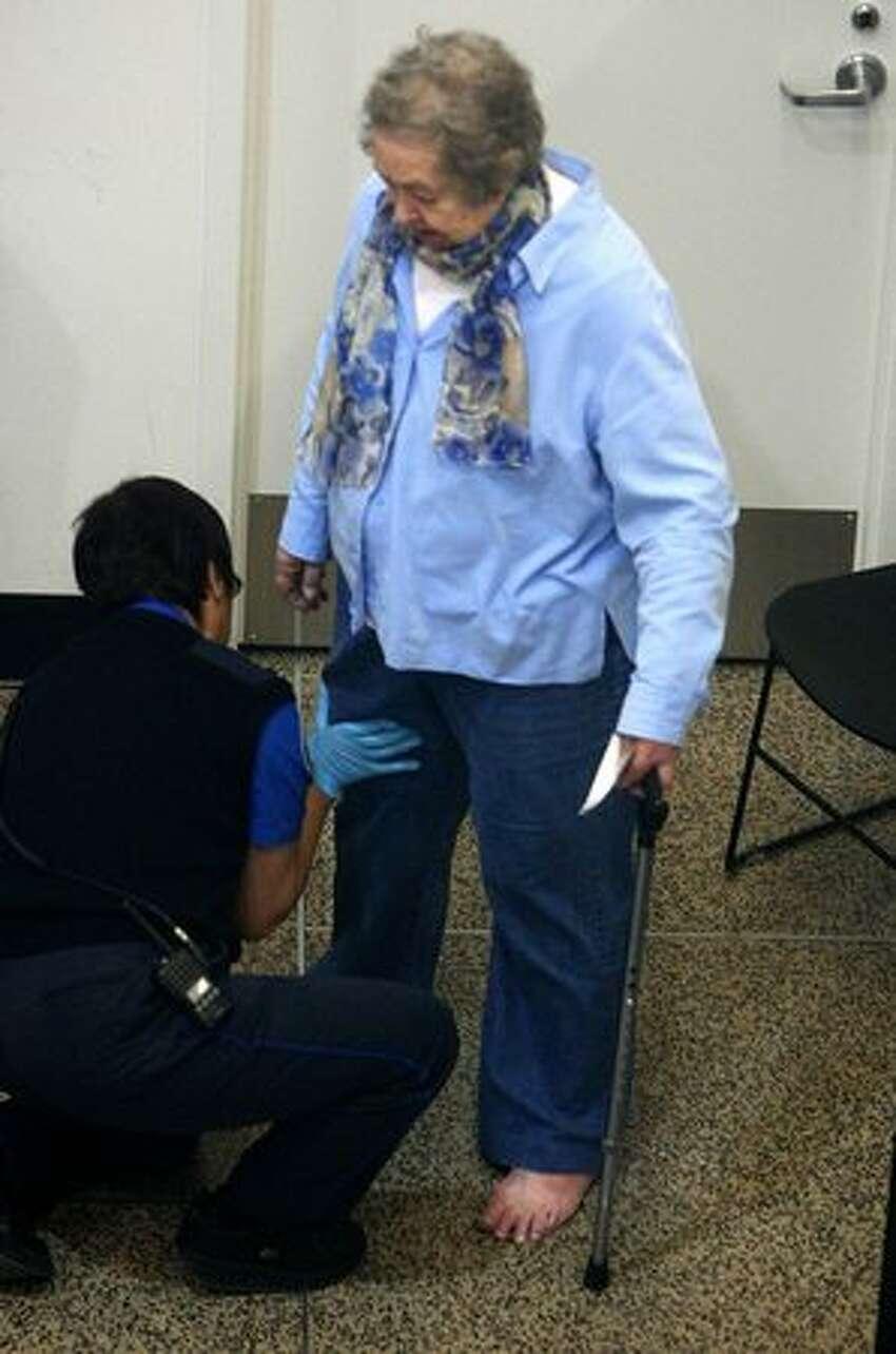 A passenger receives a pat-down by a TSA employee at Sea-Tac International Airport on Wednesday, November 24, 2010. (Joshua Trujillo, Seattlepi.com)..