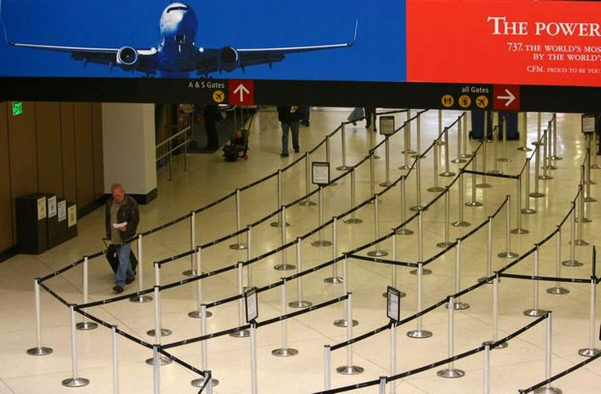 Expected lines at Sea-Tac International Airport did not materialize by mid-morning on Wednesday. Travelers passed easily through security and at check-in counters.