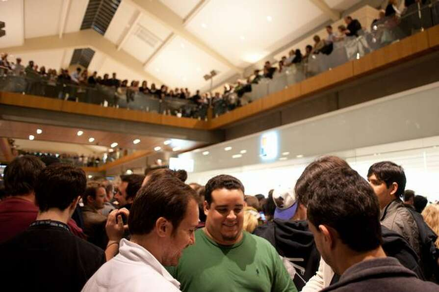 Mall-goers pack the stage in front of the new Microsoft Store in Bellevue Square to hear Dave Matthe