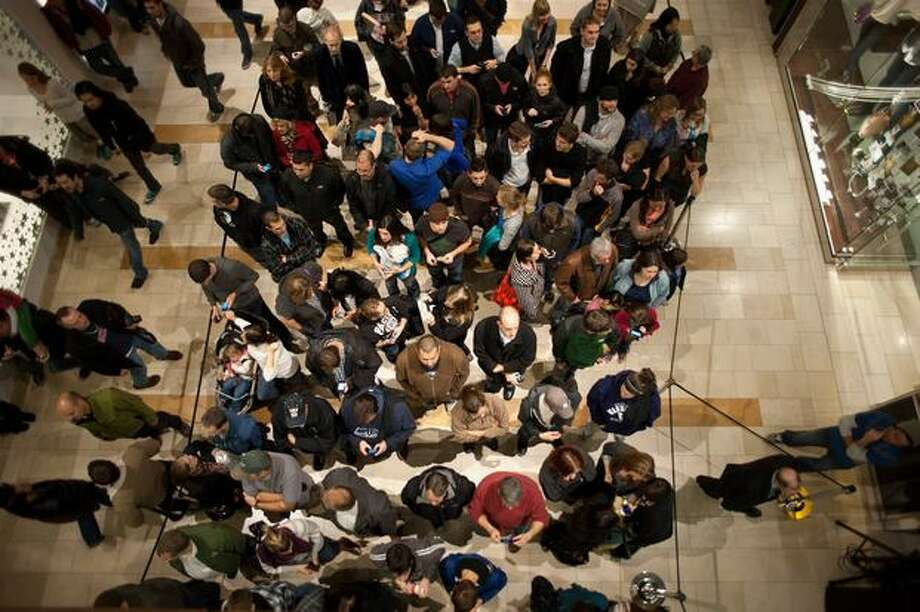 Attendees wait inside barrier lines to hear Dave Matthews play a surprise show on the opening day of the Microsoft store in Bellevue Square. Photo: Elliot Suhr, Seattlepi.com