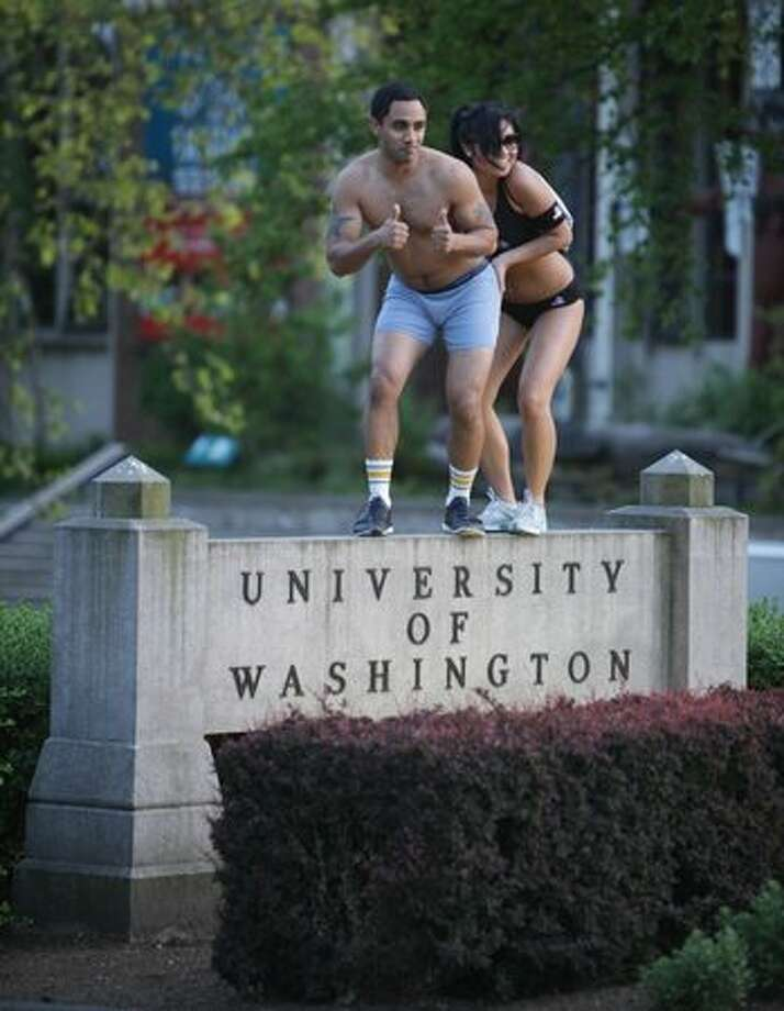 "A pair of University of Washington students strike a pose at the entrance to campus during the ""AXE Undie Run Challenge,"" a charity event held on Tuesday May 11, 2010. During the Undie Run students donated their clothes to charity and then ran a course around campus in their skivvies. Photo: Joshua Trujillo, Seattlepi.com"