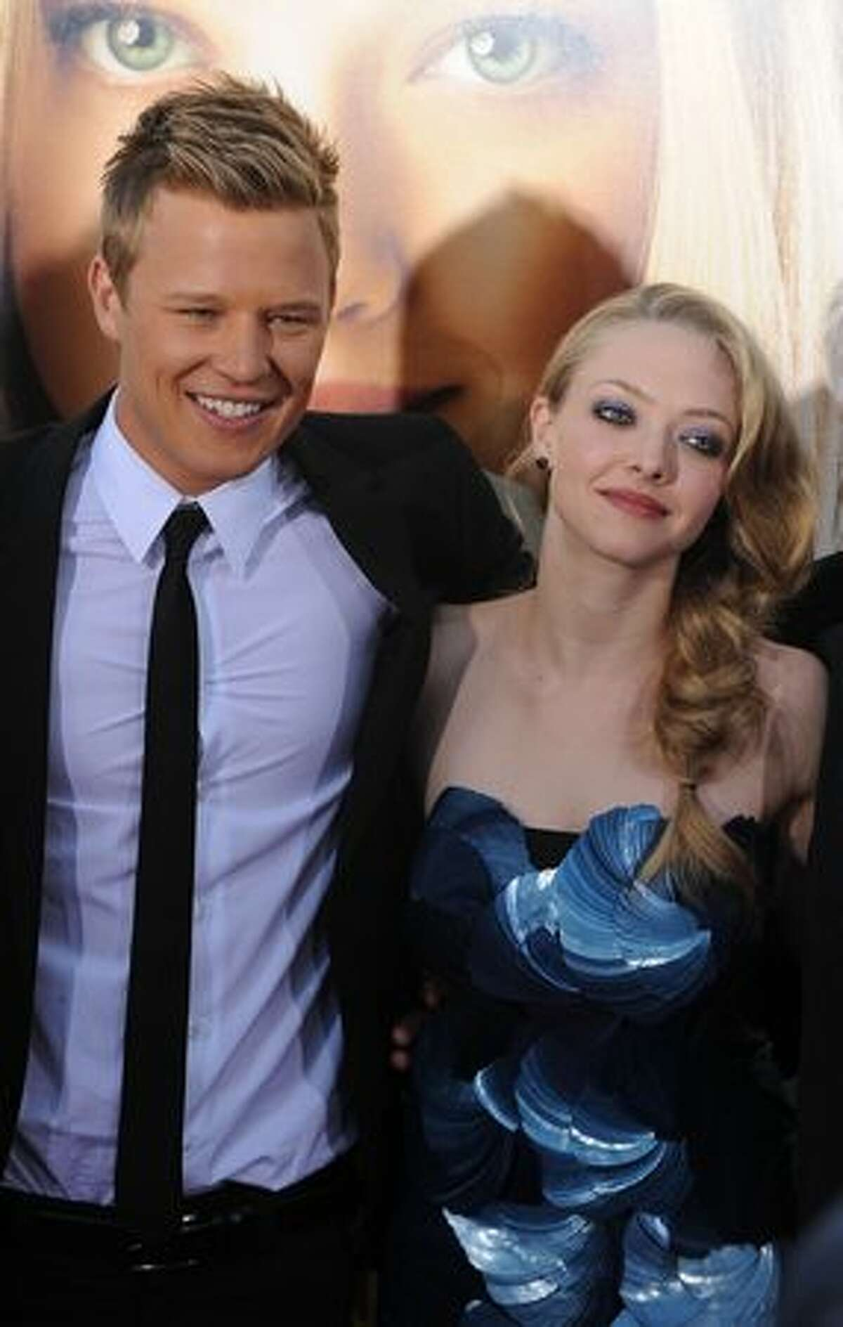 Cast members Christopher Egan (L) and Amanda Seyfried arrive at the premiere of