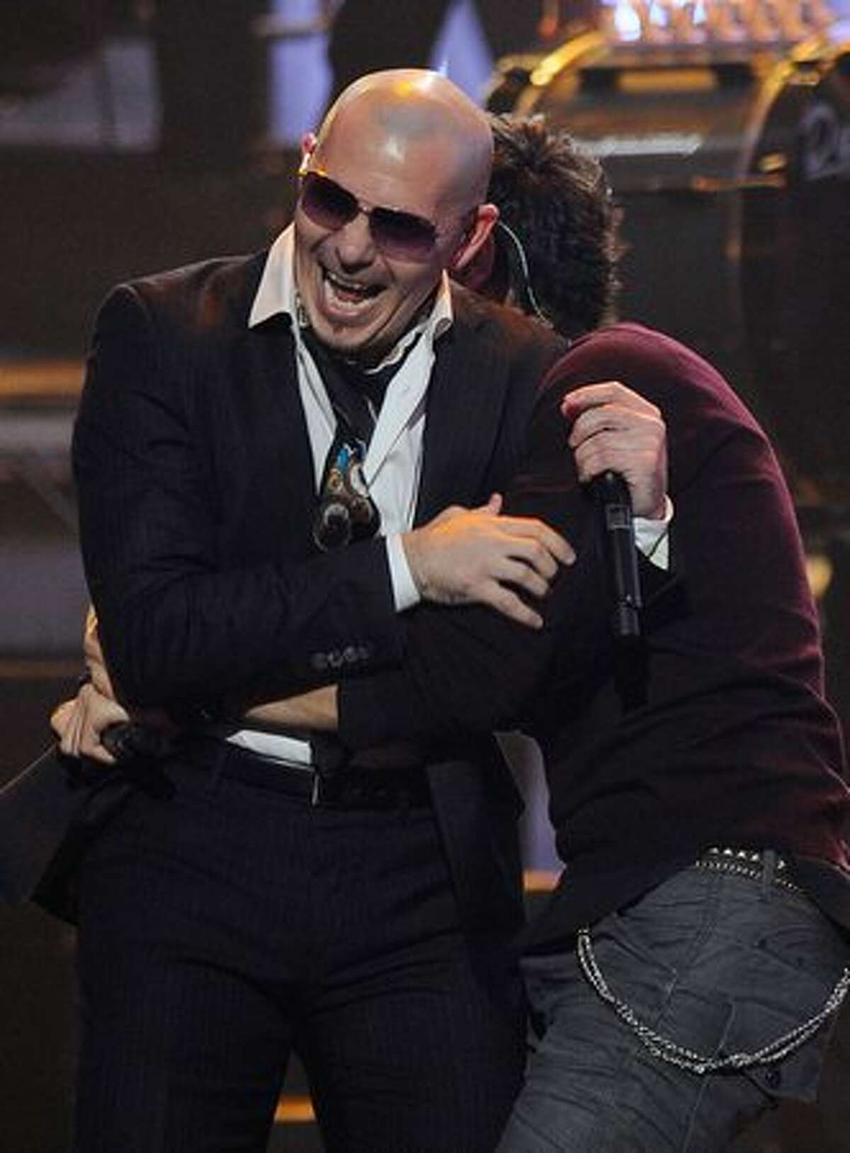Singers Pitbull and Enrique Iglesias perform onstage during the 2010 American Music Awards held at Nokia Theatre L.A. Live in Los Angeles.