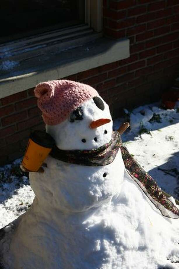 Caffeinated snowman does not care for the sunshine. Photo: Levi Pulkkinen, Seattlepi.com