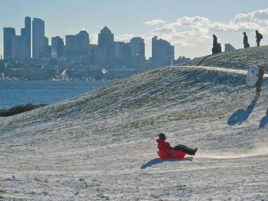 Kids of all ages slipped and slid down Kite Hill at Gasworks Park on Tuesday afternoon. Photo: David Horsey, Seattlepi.com