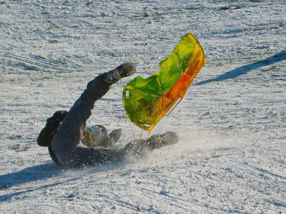 Taking a tumble at the foot of Gasworks Park's Kite Hill on Tuesday afternoon. Photo: David Horsey, Seattlepi.com