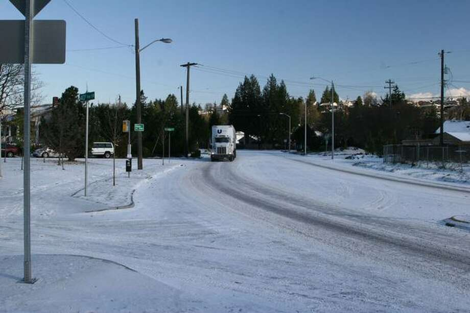 Many streets in and around Seattle remained covered in snow and ice the day after a major snowstorm. Photo: Michelle Nicolosi, Seattlepi.com