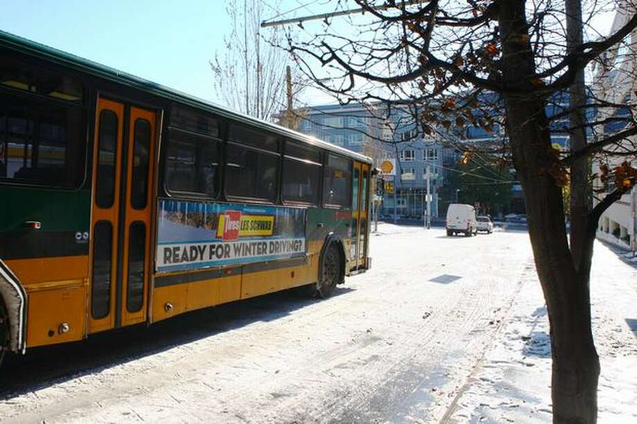 A Metro bus makes its way Tuesday toward a unusually empty Denny Way. Photo: Levi Pulkkinen, Seattlepi.com