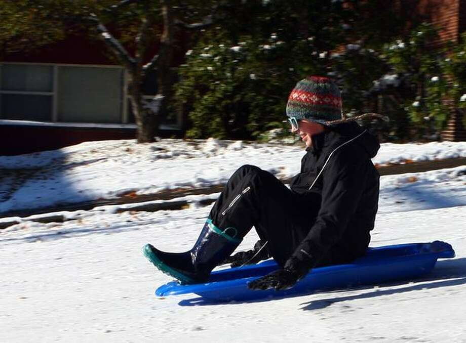 Paige Garratt, 16, enjoys her day off from Garfield High School Tuesday sliding down Queen Anne Avenue North. Photo: Levi Pulkkinen, Seattlepi.com