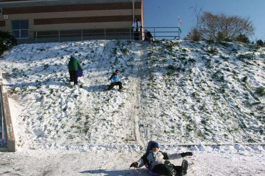 Sledding at Gatewood Elementary School in West Seattle Tuesday afternoon. Photo: Michelle Nicolosi, Seattlepi.com