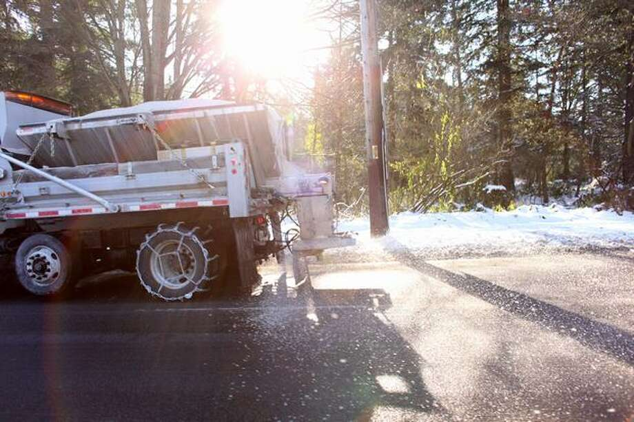 Salt falls from a truck the morning after snow and ice wreaked havoc with Seattle-area roads. A combination of sun and the salt is helping to clear some main Seattle thoroughfares. Photographed on Tuesday, November 23, 2010. Photo: Joshua Trujillo, Seattlepi.com