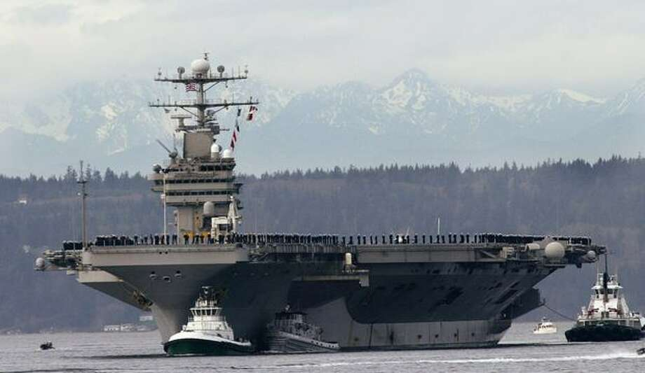 With sailors lining the rails, the USS Abraham Lincoln aircraft carrier makes its way to its home port at Naval Station Everett on Friday, March 4, 2005, after a five-month deployment at sea. U.S. Sen. Patty Murray, D-Wash., announced on Dec. 9, 2010, that the USS Nimitz would be based at Naval Station Everett to replace the departing Abraham Lincoln. (AP Photo/Ted S. Warren)