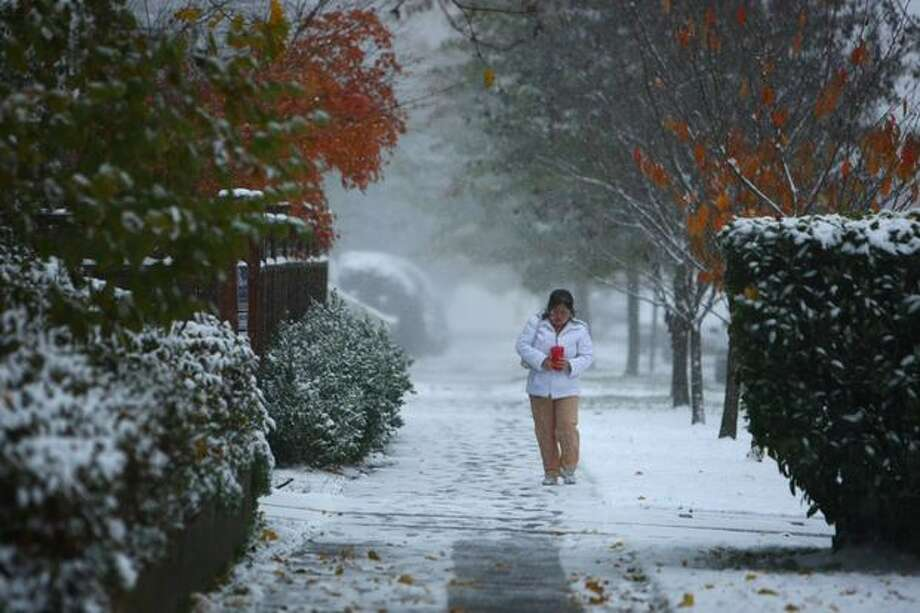 A woman walks in Seattle's Beacon Hill neighborhood. Photo: Joshua Trujillo, Seattlepi.com