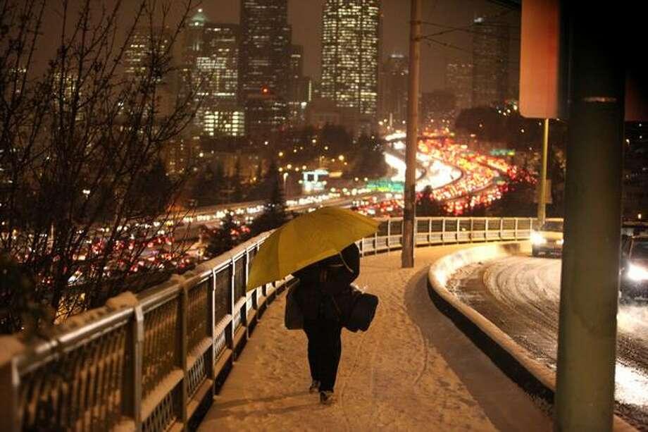 A pedestrian walks on the 12th Avenue South bridge. Photo: Joshua Trujillo, Seattlepi.com