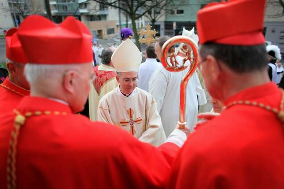 The Most Rev. J. Peter Sartain, center, speaks with, from left, Cardinal Donald Wuerl, Cardinal Francis George and Cardinal Roger Mahony before an installation ceremony at Saint James Cathedral on Wednesday, December 1, 2010. Photo: Joshua Trujillo, Seattlepi.com