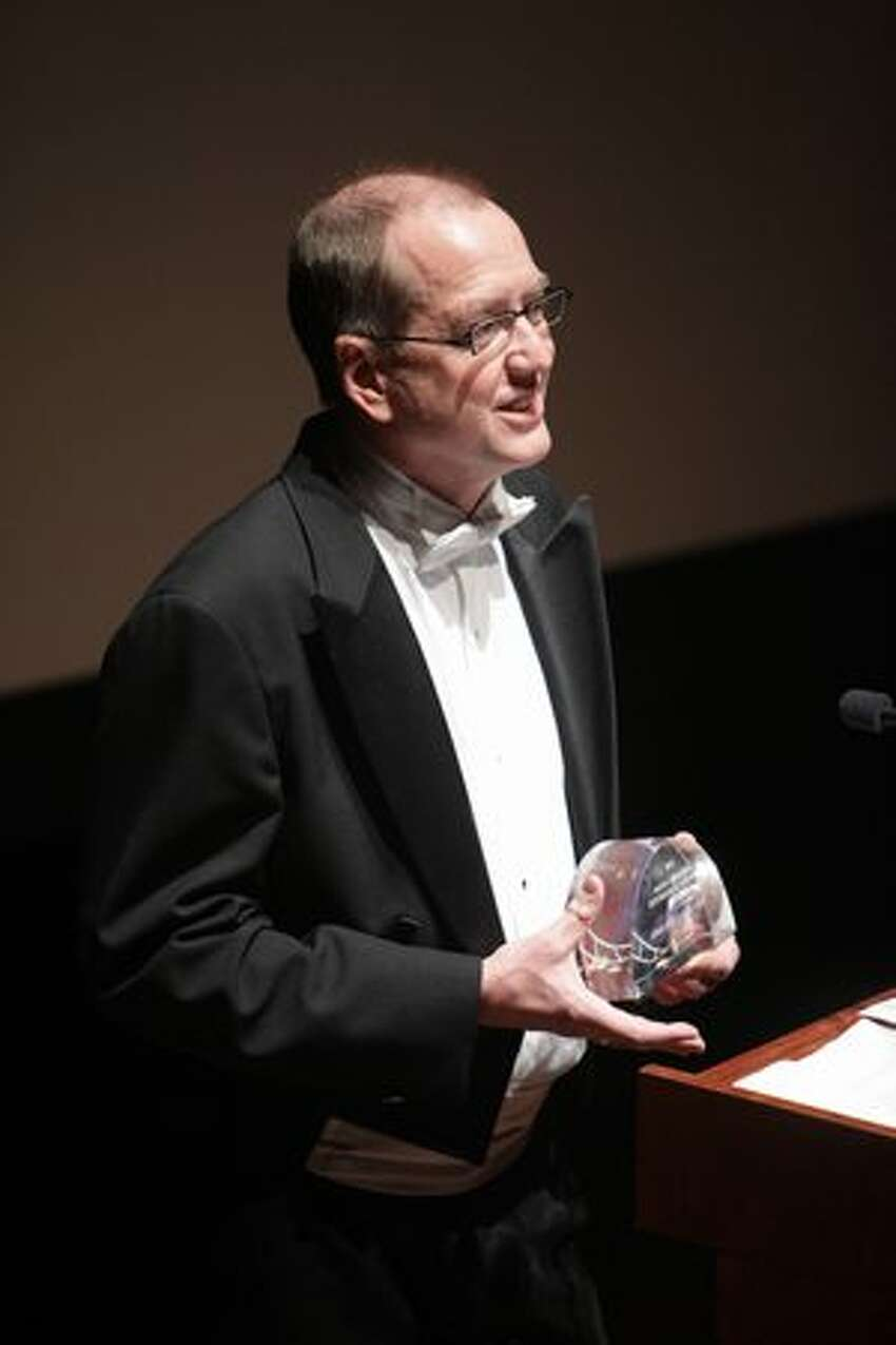 Musician David Sabee of Seattle, who's had a hand in the musical scores of dozens of films, accepts the Mayor's Award.