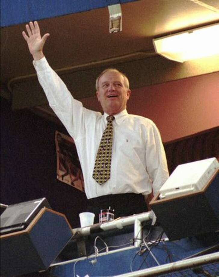 Seattle Mariners longtime radio announcer Dave Niehaus waves from the Kingdome broadcast booth Sept. 22, 1996.  The appearance was Niehaus' first since a second angioplasty sidelined him earlier in the month. (Robert Sorbo/The Associated Press/seattlepi.com file) Photo: P-I File