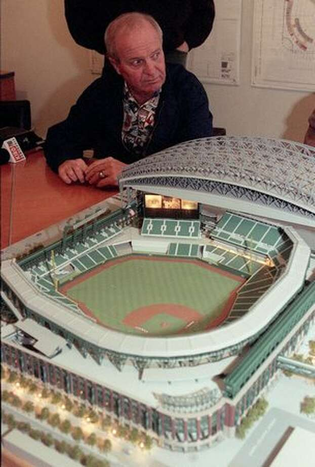 Dave Niehaus looks at a model of Safeco Field, October 1996. (Phil H. Webber/seattlepi.com file) Photo: P-I File