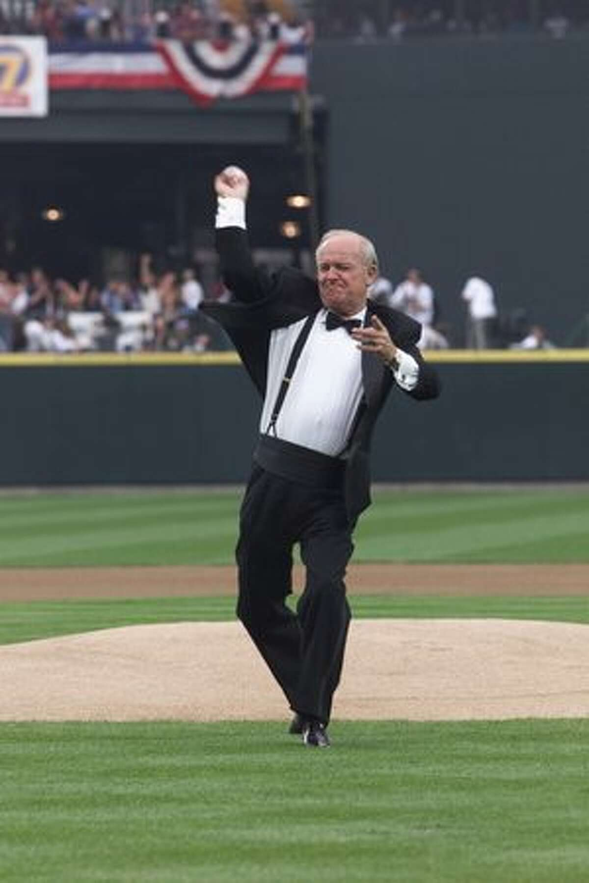Dave Niehaus throws out the first pitch at the opening of Safeco Field, July 15, 1999. (Mike Urban/seattlepi.com file)